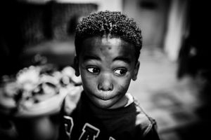 Black and white photo of a young Black boy