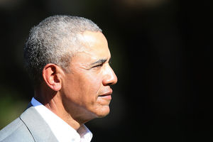 Barack Obama. Black man in tan suit in profile