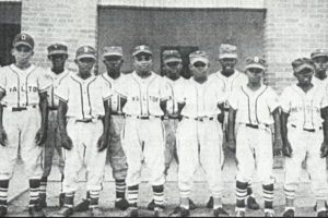 Black-and-white photo of Black children in baseball uniforms