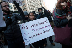 Immigrants and their supporters rally in New York City during a protest against recent Immigration and Customs Enforcement raids on February 16, 2017.