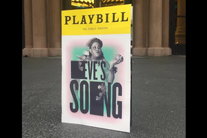 "Poster with yellow top bar and black text reading ""PLAYBILL"" and Black woman on white and pink and turquoise background behind black text that reads ""EVE'S SONG"" on grey pavement in front of brown building"
