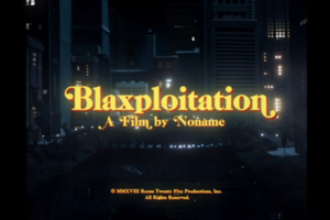 "Yellow text reading ""Blaxploitation A Film by Noname"" hovers over black and navy city buildings and sky and yellow lights"
