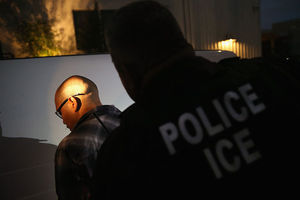 A man is detained by Immigration and Customs Enforcement (ICE) agents in Los Angeles, California.