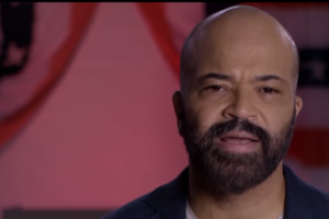 Jeffrey Wright. Black man in close up with red, white and blue decorations behind him.