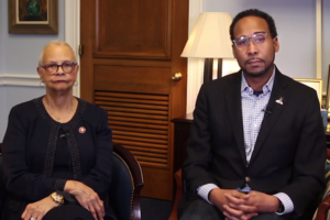 Bonnie Watson Coleman and David Johns. Two Black people in dark jackets sit in room facing camera