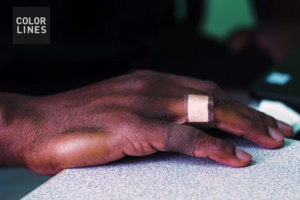 Brown hand with brown bandage and tan bandage on fingers