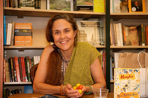 Naomi Shihab Nye. Arab American woman with long side ponytail wearing green shawl.