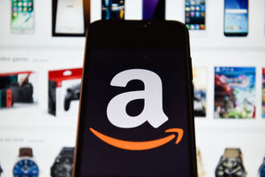 Photo illustration of an Amazon logo seen displayed on a smart phone