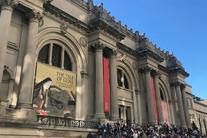 Exterior of Metropolitan Museum with crowd on steps