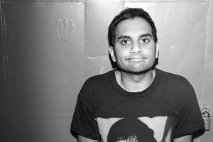 Aziz Ansari. Indian man with short dark hair wearing black t-shirt.