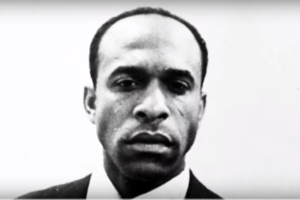 A black and white photo of Frantz Fanon