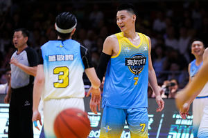 Jeremy Lin. Asian American man on basketball court wearing blue uniform.