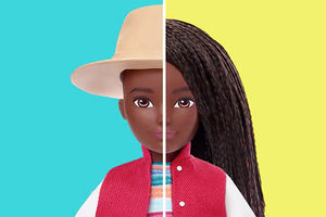 Mattel Doll. Gender-fluid Black doll shown wearing long braids and also wearing a fedora.