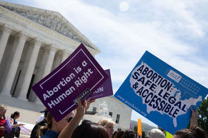 Protesters hold signs in support of abortion rights outside of Supreme Court.