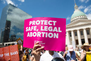 Pink and white sign in support of abortion rights held outside Old Courthouse in St. Louis, Missouri