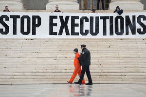 Randy Gardner is removed by police while wearing his executed brother's prison jumpsuit during an anti death penalty protest at the US Supreme Court in Washington, D.C. on January 17, 2017.