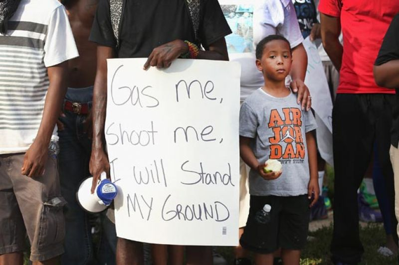 Officer Darren Wilson to Young Woman: 'Shut the F Up, Sit the F Down'